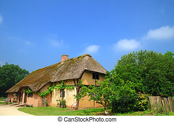 Rural belgium, historical preserved farm house with reed roof. Vintage, culture concept.