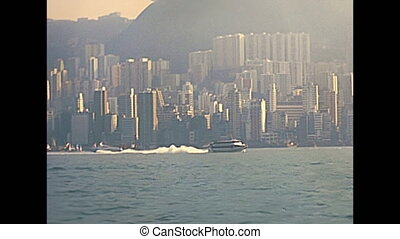 Historic ferry speed boat in Hong Kong Victoria Harbour in 1980. Historic restored footage on 1980s.