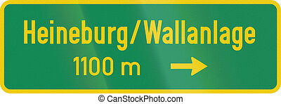 Historic German road sign about a place of interest -...