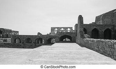 Historic Golconda fort built in monochrome near Hyderabad, India