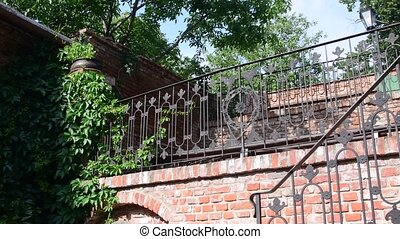 Historic house with wrought-iron banisters. Historical...