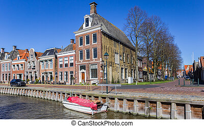 Historic houses at the quay in Harlingen, Netherlands