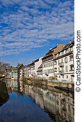 Historic houses on quay of Ill river. Strasbourg, France
