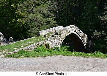 Historic Medieval Stone Beggar's Bridge Over a River in England