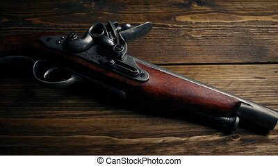 Historic Pirate Gun On Table - Old flintlock hand gun on...