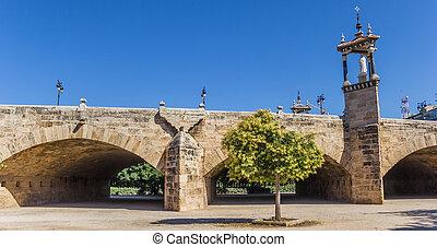 Historic Puente del Real bridge in Turia river park in Valencia