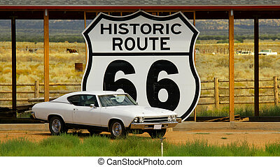 Old car and Route 66 sign by the historic road 66