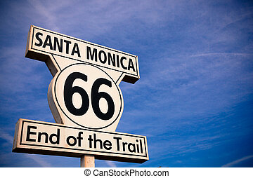 The Historic Route 66 Santa Monica Sign with a sky blue background
