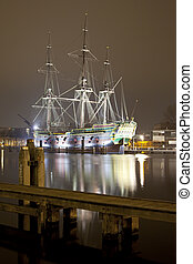 historic ship Amsterdam at night in harbor of Amsterdam, The Netherlands