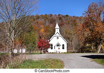 Historic small church in the middle of beautiful autumn...