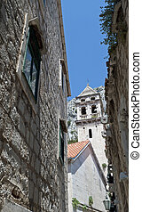 Historic stone buildings and a church in Croatia