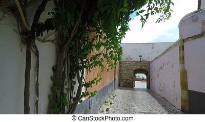 Historic streets of the old town of Faro in motion....