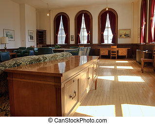 A teachers lounge and boardroom in a historic school.