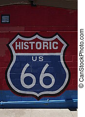 Historic us 66 sign on brick background. Close up