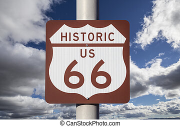 Historic US Route 66 Highway Sign with Cloudy Sky.