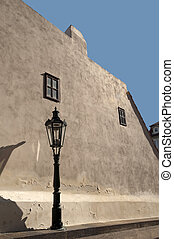 Historic wall with windows and street light