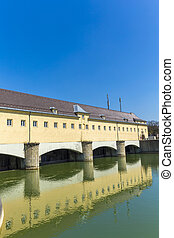 Historic weir at the river Isar  in Munich