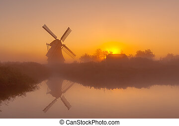 Historic windmill along a canal - Characteristic historic ...