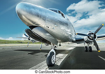 aircraft - historical aircraft on a runway ready for take...