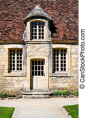 Historical building entrance door with vintage windows
