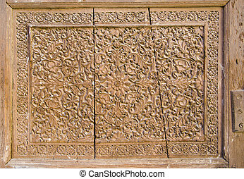 historical carved wooden door background in India