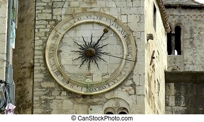 Close-up view of the historical clock under bell tower in Diocletian's Palace, Split, Croatia.