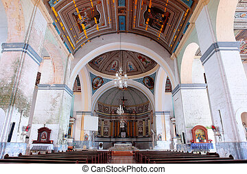 Interior of the historical baroque Filipino church in the coastal town of Loon, Bohol, Philippines. The Birhen sa Kasilak (Our Lady of Light) was transferred here in 1610 after Muslim bandits attacked and looted Butuan, Mindanao. Largest in the Visayas.