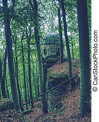 Historical gazebo with reneval cupola roof stands on  rock i
