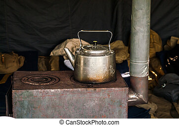 Historical gray iron kettle on the stove plate