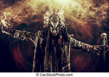 historical hero - Full length portrait of a male shaman in...
