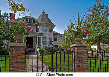 Old victorian home with fence.