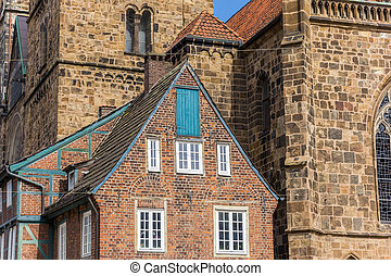 Historical house in front of the church in Bremen, Germany