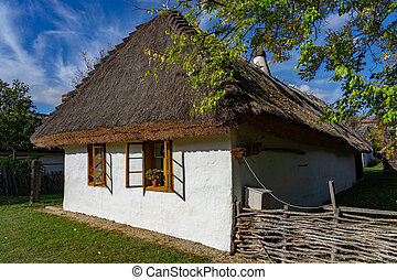 Historical old hungarian village with straw roof house in museum