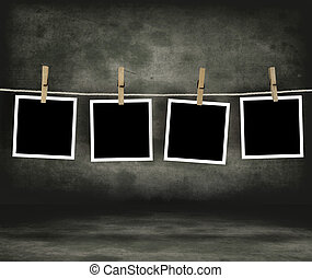 Historical photo concept. Old photo film blanks hanging on a...