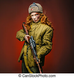 Historical reenactment of soviet union army by pretty girl with mosin-nagan in beautiful light on red background