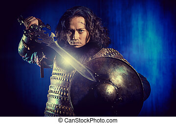 historical scene - Ancient male warrior in armor holding...