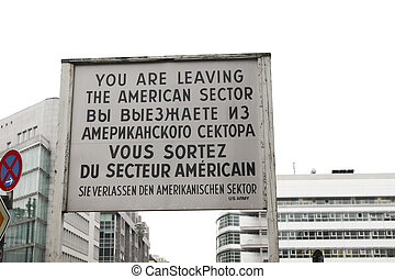 Historical sign at checkpoint charlie in Berlin - Old sign...