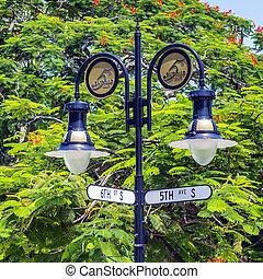 historical street sign in Naples, Florida under blue sky -...