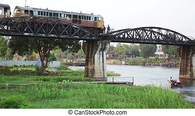 historical train at bridge over kwai river death railway