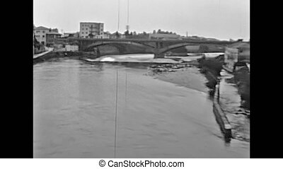 The historical Vittoria new bridge or Ponte Nuovo of Bassano del Grappa town in Italy on Brenta river. Historical 1960 footage.