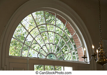 historical window - semicircle of a window with candelabrum...
