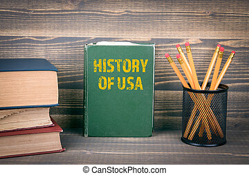 History of USA concept. Book on a wooden background