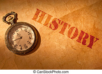 History etched on an old paper scroll with a vintage clock