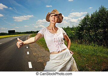 Hitchhiker girl in cowboy hat.