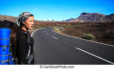 hitchhiker / travel - Woman traveler on the roadside on ...