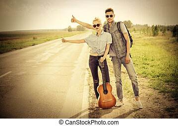 passing car - Hitchhiking couple. Romantic young people ...