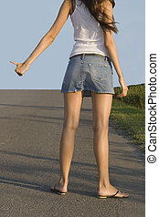 hitchhiking girl on the street