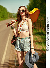 hitchhiking hippie girl - Pretty hippie girl with a guitar ...