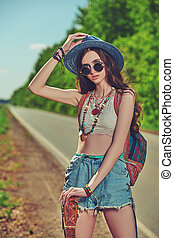 hitchhiking on the road - Pretty hippie girl hitchhiking ...