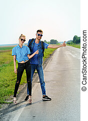 hitchhiking young couple